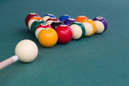 Cue aiming white ball to break snooker billards on green table