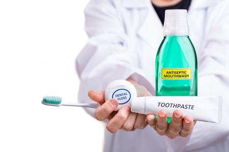 Dentist recommend soft tapered bristle toothbrush, toothpaste, mouthwash, dental floss as  essential oral health products Stock Photo