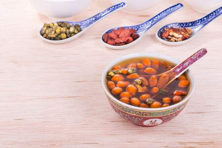 chinese wolfberry: Goji berries or Wolfberry, Chrysanthemum, and Red Dates tea is traditional remedy to improve eyesight Stock Photo