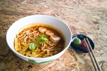 Authentic Sarawak laksa noodle with prawn, egg strips and chili paste