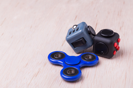 reliever: Fidget spinner and fidget cube, the latest stress relieving craze on table top