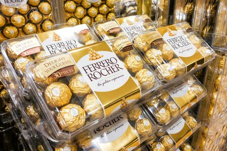 ferrero: KUALA LUMPUR, Malaysia, June 3, 2017: Ferrero Rocher is a spherical chocolate produced by the Italian chocolatier Ferrero SpA. It is popular as festive gift.