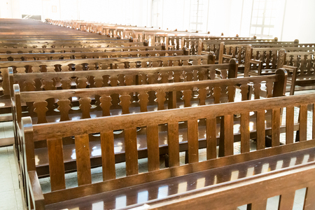 Rows of empty pew benches in chapel church
