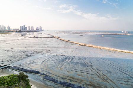 dredging: Sea land reclaiming activity at Gurney drive Penang Malaysia, Asia Stock Photo