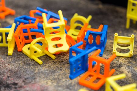 Heap of colorful stacking chair game toy on table