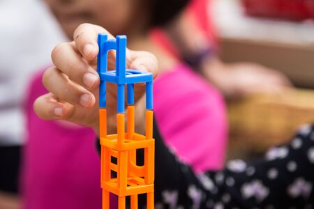 Kids playing the stacking chairs game during recreational party