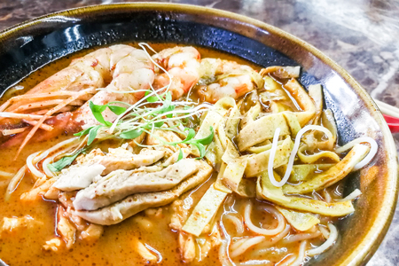 Close-up of authentic delicious Sarawak Laksa with big prawns, popular food in Malaysia