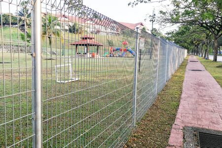 metal mesh: Security fencing at residential home to prevent trespassing of private property