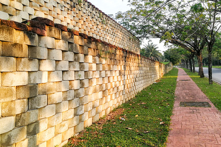 Interlocking designed retaining wall to manage earth erosion and  landscaping