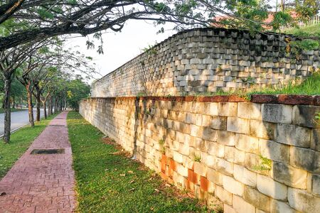 Interlocking designed retaining wall to manage earth erosion and  landscaping