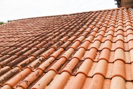 Moldy roof tiles in humid tropical climate in Malaysia Stock Photo