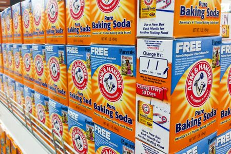 neutralizer: KUALA LUMPUR, Malaysia, August 25, 2017: Arm & Hammer Baking Soda is the trademark of Church & Dwight Co., Inc.  Block displayed in supermarkets, It is the leading premium baking soda brand in Malaysia.