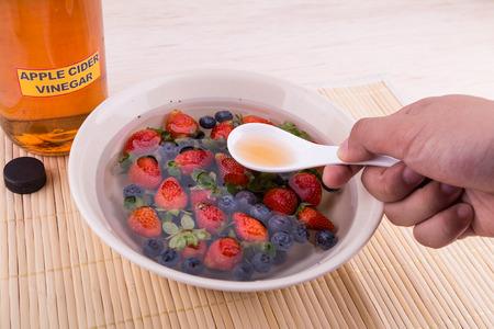 Apple cider vinegar neutralize pesticides found on fruits and vegetable from commercial agriculture Reklamní fotografie