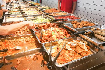 People picking variety of food at Chinese economy rice stall in Malaysia Stock Photo