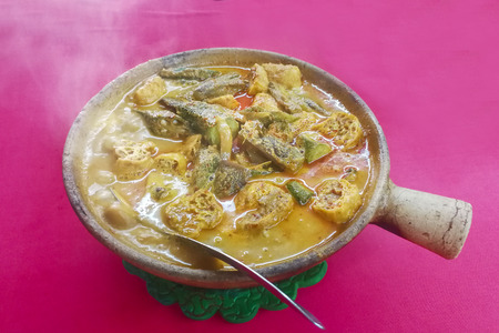 Steamy hot clay pot fish head curry Chinese style popular delicacy in Malaysia Stock Photo