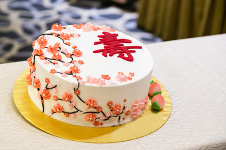 Decorated birthday cake celebration for eldery person with Chinese word Longevity Stock Photo