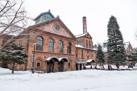 Sapporo, Japan, January 28, 2018:  Sapporo Beer Museum is popular tourist attraction.  Featured here is the main red brick building during winter with heavy snow.