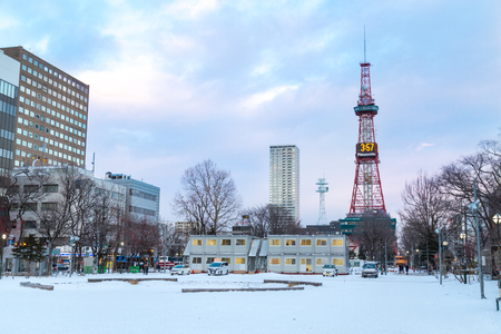 Sapporo, Japan, January 2, 2018: Eastern end of Odori Park stands the Sapporo TV Tower, which has an observation deck. Featured here the popular icon during winter.