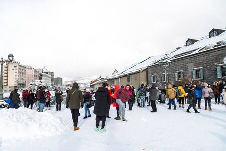 Otaru, Japan, January 28, 2018:  Otaru canal with nostalgic buidings is popular tourist destination in Hokkaido.  Featured here tourists enjoying during winter with thick snow. Editorial