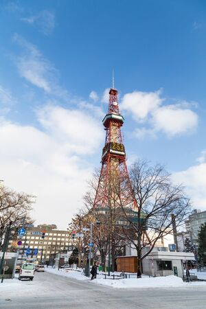 Sapporo, Japan, January 28, 2018: Eastern end of Odori Park stands the Sapporo TV Tower, which has an observation deck. Featured here the popular icon during winter. Editorial
