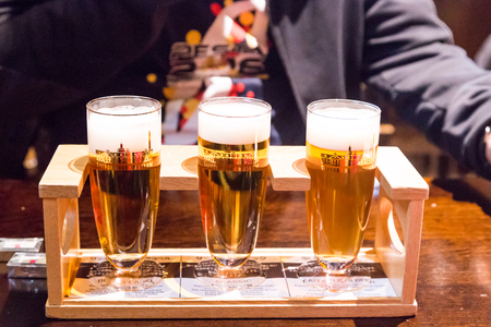 Sapporo, Japan, January 28, 2018:  Sapporo Beer Museum is popular tourist attraction. Sampling of different beer brew avaiable for a token. Stok Fotoğraf - 95865806