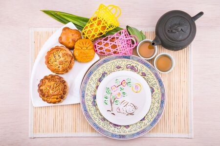 Overhead view on ariety of mooncakes for Chinese mid-autumn festival celebration served with tea