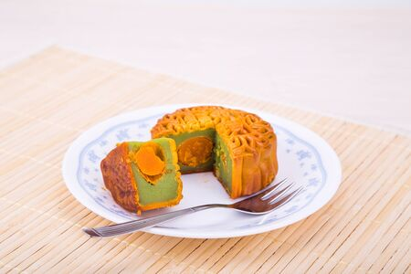 Mooncake with egg yoke for Chinese mid-autumn festive served on plate