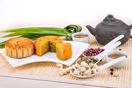 Mooncake for Chinese mid-autumn festival celebration, wih ingredients and tea on table top 版權商用圖片 - 99533480