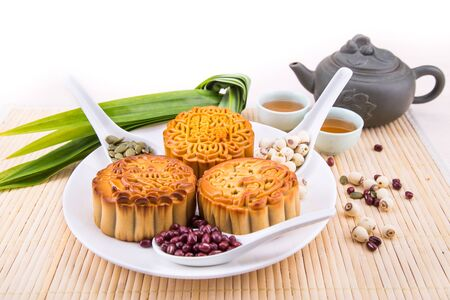 Mooncake for Chinese mid-autumn festival celebration, wih ingredients and tea on table top 版權商用圖片 - 99533483