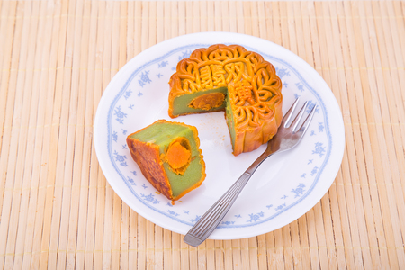 Overhead view of mooncake with egg yoke for Chinese mid-autumn festive served on plate 版權商用圖片