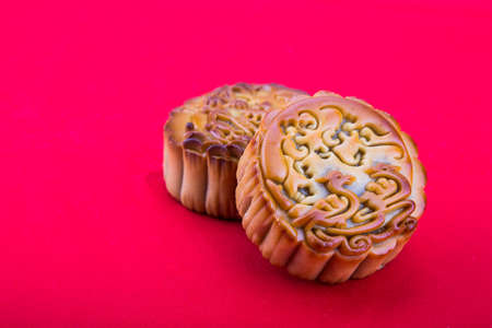 Close-up on mooncake, pastries for Chinese mid-autumn festive in red background