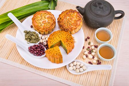 Mooncake for Chinese mid-autumn festival celebration, wih ingredients and tea on table top 版權商用圖片 - 99533564