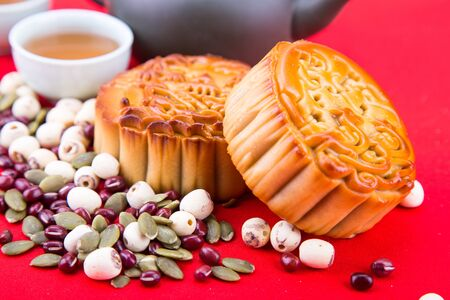 Close-up on Mid Autumn festival Chinese mooncake  with ingredients and tea on table top 版權商用圖片 - 99533586