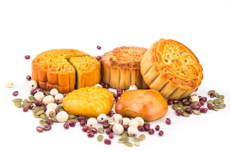 Mid Autumn festival Chinese mooncake  with nuts and seeds ingredients on white background Stock Photo