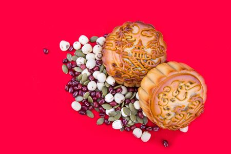 Close-up on mooncake with ingredients, pastries for Chinese mid-autumn festive in red background 版權商用圖片 - 99533651