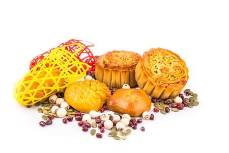 Mid Autumn festival Chinese mooncake  with nuts and seeds ingredients on white background 版權商用圖片
