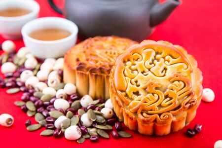 Close-up on Mid Autumn festival Chinese mooncake  with ingredients and tea on table top 版權商用圖片 - 99533674