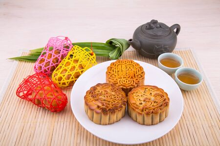 Variety of mooncakes for Chinese mid-autumn festival celebration with tea