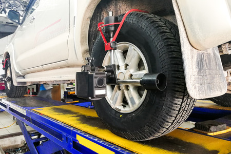 Car undergo wheel align in garage with precision alignment equipment