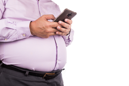 Big belly man with visceral subcutaneous fats in tight and uncomfortable shirt Stock Photo
