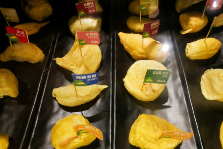 Variety of durian breed flesh in restaurantt for patron trial sampling and comparison including Musang King.