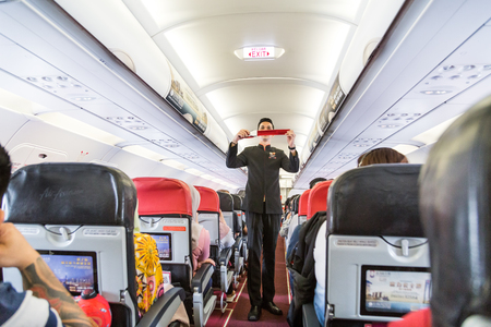 KUALA LUMPUR, MALAYSIA, August 20, 2018: Series of steward demonstrating safety prosedure prior to commercial Airasia airline flight took off.