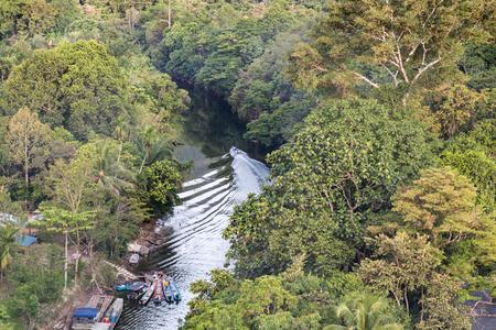 Aerial view of lush green jungle surrounding Merlinau river at Mulu National Park, Sarawak, Malaysia