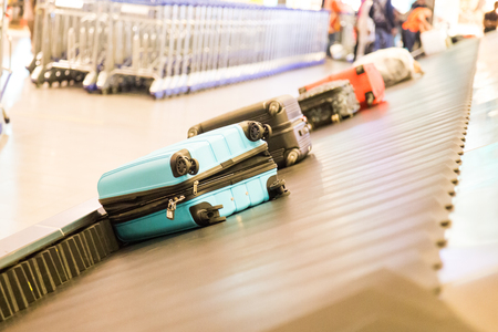 Closeup of luggage bag on airport conveyor belt for pickup 写真素材