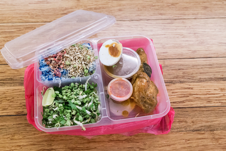 Convenient but environmental unfriendly plastic meal containers and pvc bag as takeaways.