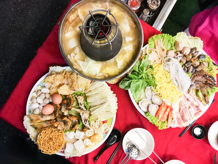 Hot pot or steamboat Asian style with meat, seafood, vegetable noodle served on charcoal powered pot Banque d'images