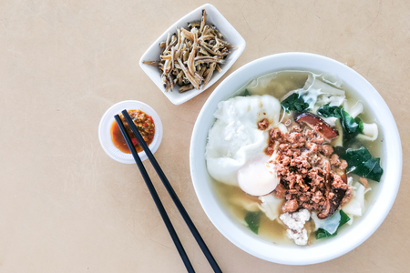 Bowl of delicious Pan Mee noodle soup, popular Chinese food in Malaysia. Stock Photo