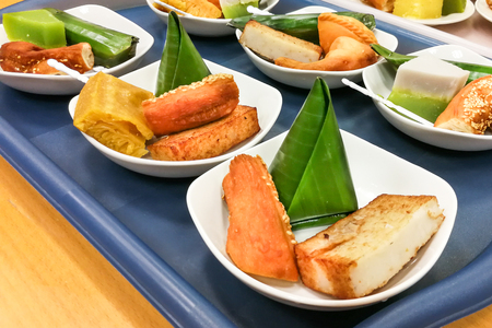 Assorted Malaysia Nyonya kuih kueh served on serving plate on tray Stock Photo