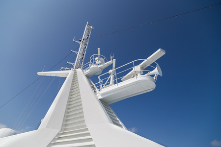 Closeup of cruise ship satelite radar antenna  against blue sky Banco de Imagens