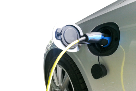 Closeup of electric hybrid car being charged with socket on wall Reklamní fotografie